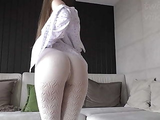 white pantyhose exceeding naked elastic ass of a young girl