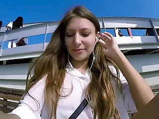 Talia Virgin plays in public with remote control trifle over burnish apply phone with head